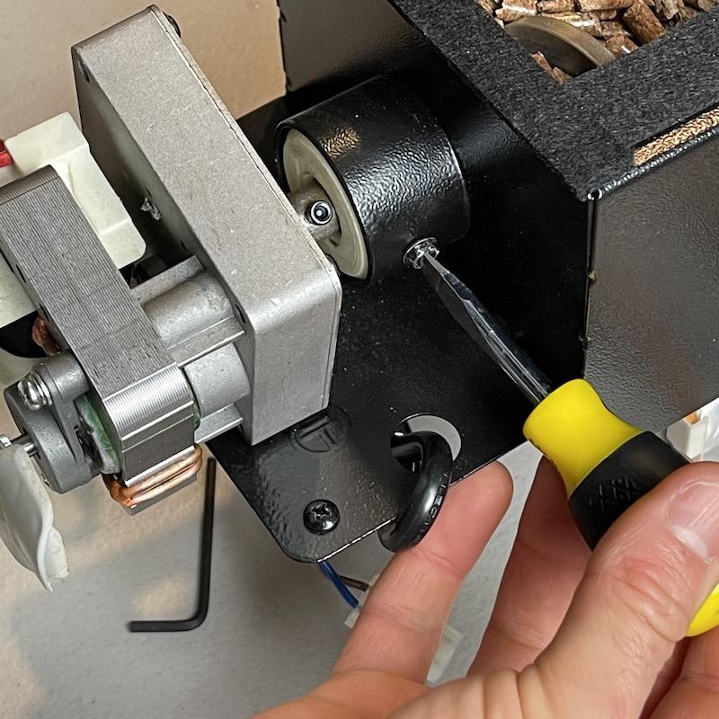 Remove screw in side of tube